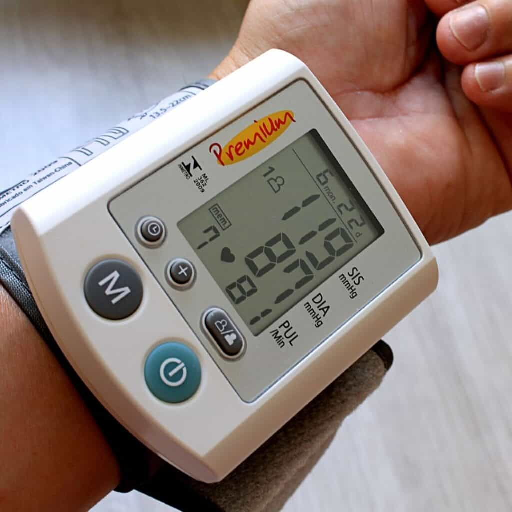 blood pressure cuff on arm