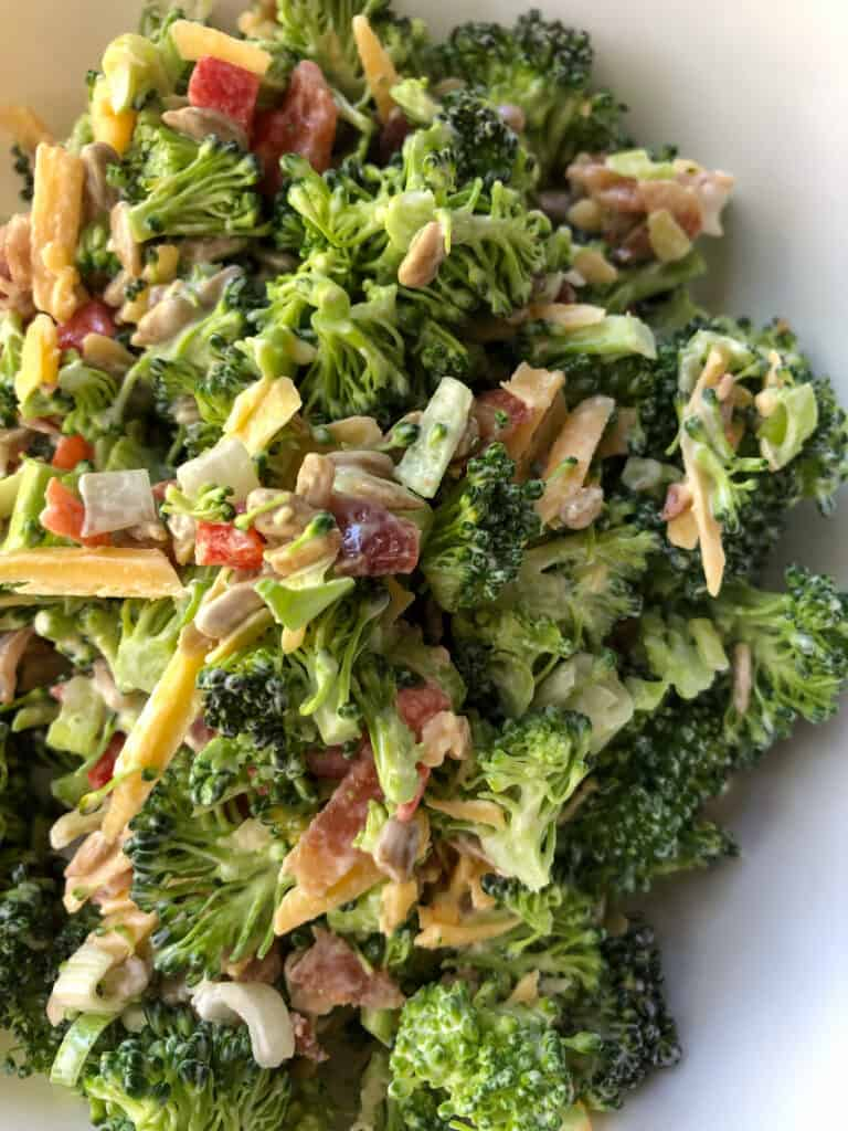 broccoli salad in white bowl