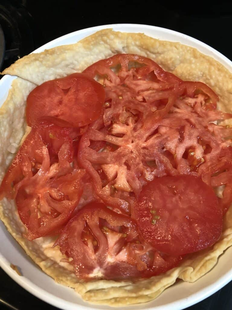 tomatoes layered in baked crust
