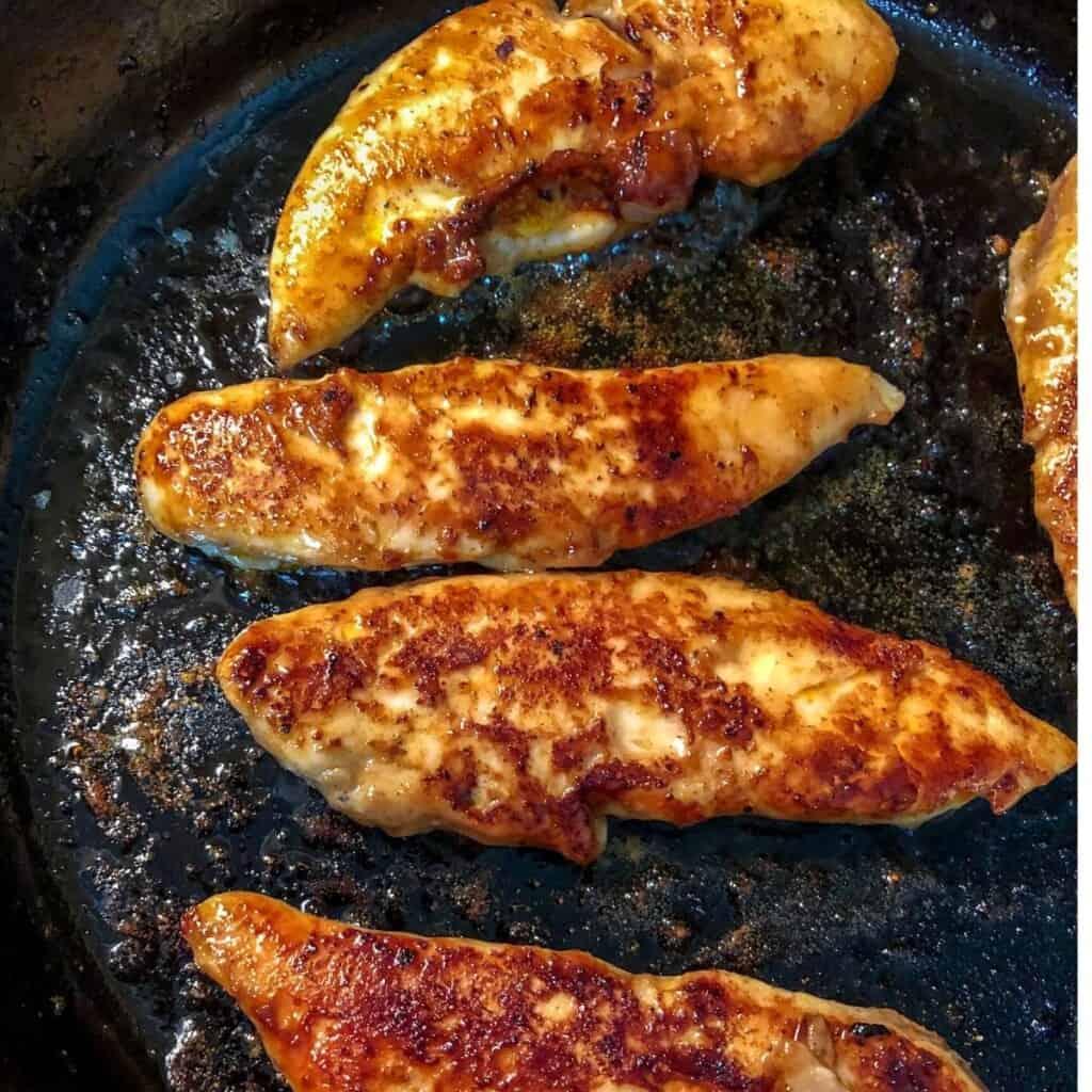 cooked chicken tenders in skillet