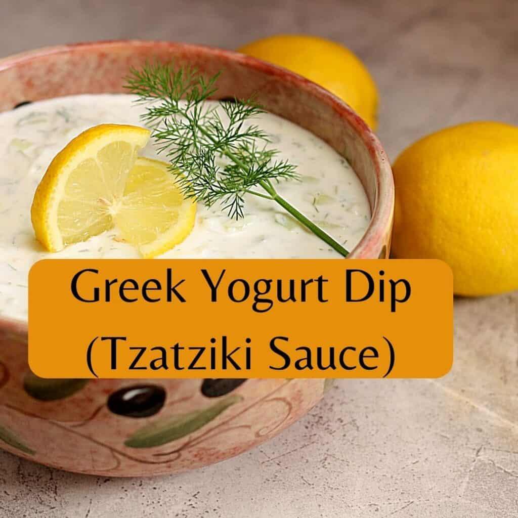 greek yogurt dip in bowl with lemon slice