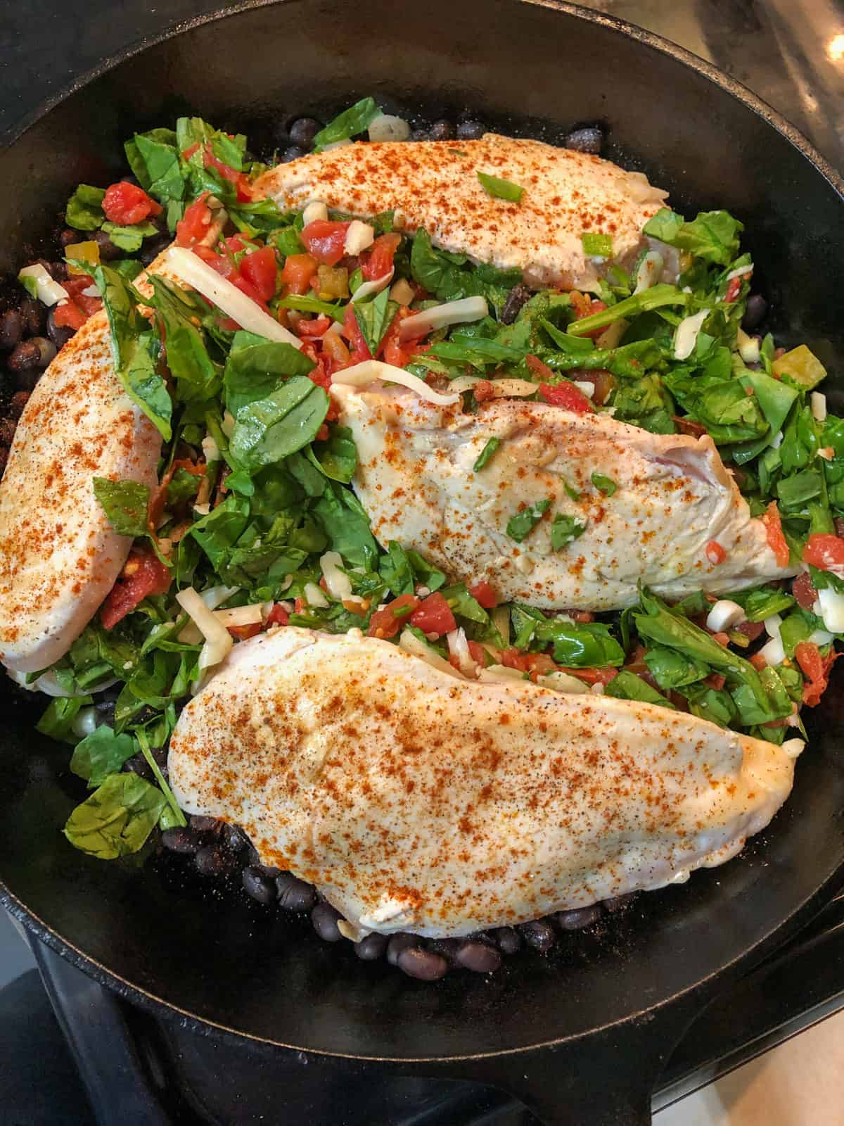 chicken breasts stuffed with spinach in skillet