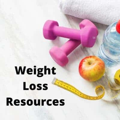 weights, apple, water bottle and tape measure