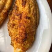 air fryer catfish on white plate