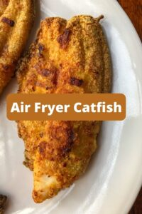 air fryer catfish on white plate with graphic