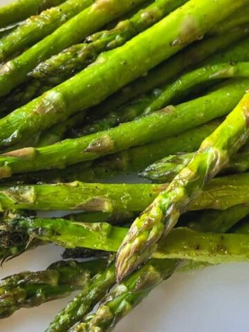 air fryer asparagus on white plate