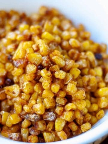 roasted corn kernels in white bowl