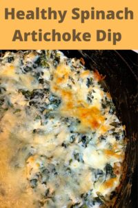 golden brown cheese melted on spinach artichoke dip in black skillet