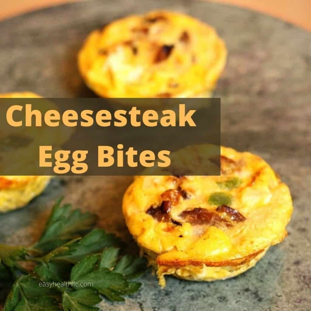 cheesesteak egg bites with parsley on marble plate