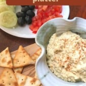 hummus in grey bowl with pita chips
