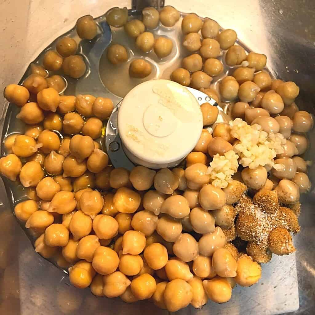 chickpeas and spices in food processor