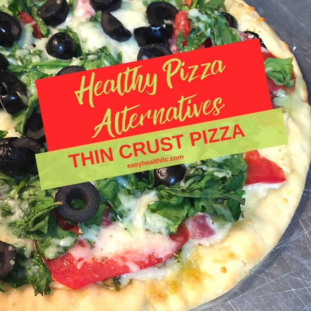 thin crust pizza with chopped spinach cheese and tomatoes