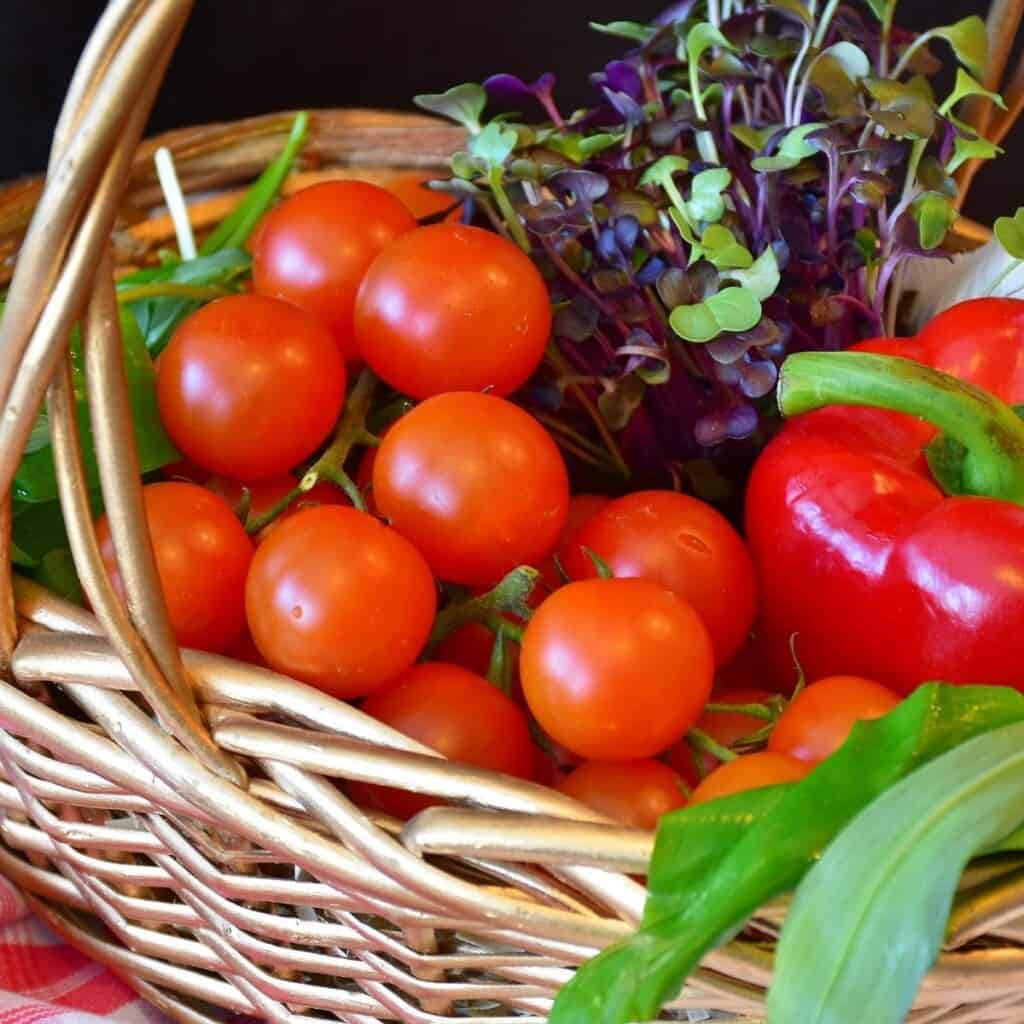 basket of red cherry tomatoes  and red bell pepper