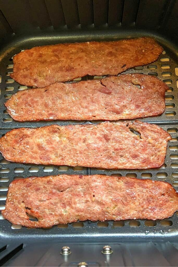 slices of cooked turkey bacon in air fryer