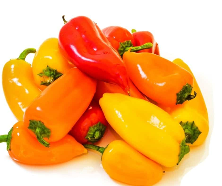 yellow and red mini peppers stack