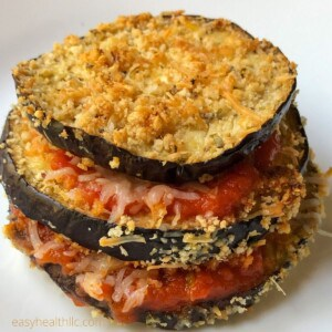 baked eggplant slices layered with tomato sauce